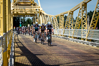 2015 Amgen Tour of California, Stage01, Peloton, led by GuillaumeVANKEIRSBULCK(BEL-EQS), MattBRAMMEIER(IRL-MTN), PeterVELITS(SVK-EQS) cross Sacramento River on CA160