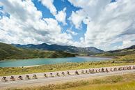 2015 Tour of Utah Stage 6 Peloton race past Reservoir