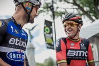 2016 Grands Prix Cyclistes de Québec et de Montréal, Montreal Race, Depart, GregVANAVERMAET(BEL-BMC), race winner, laughs with TomBOONEN(BEL-EQS) on the Start line, Sir George Etienne Cartier Monument Monument in background.